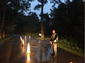 Rockport Police Officer Robert Shaw was first at the site of the expanding water main break July 15.